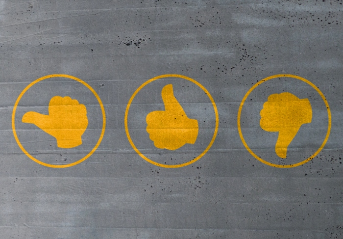 thumb valuation icons on cement concept